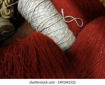 Cotton yarn wool and Thread to crochet, knit, weave.  bobbins  whit wool and cotton in red , white, blue on cones for handicrafts.