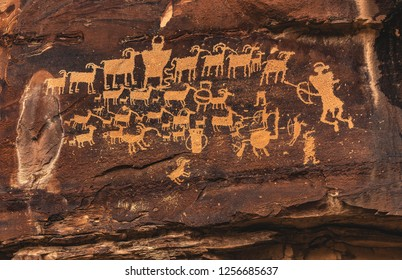"""The Cottonwood, or """"Great Hunt"""" petroglyph panel in Nine Mile Canyon, northeast of Price, Utah, USA.  Called the """"longest art gallery in the world,"""" the rock art is mainly Ute and archaic Fremont."""