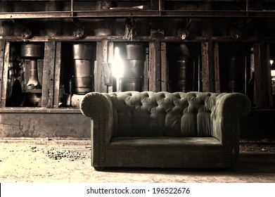 Couch in an abandoned industrial background