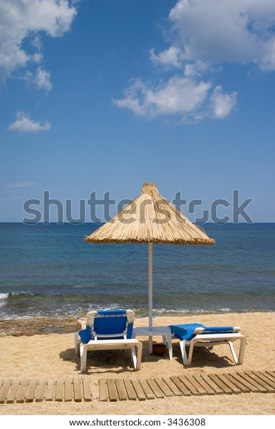 couch and sunshade on the seaside