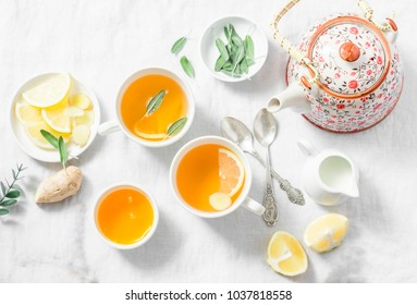 Cough tea. Green tea with lemon, ginger, sage on a light background, top view. Healthy detox drink. Flat lay