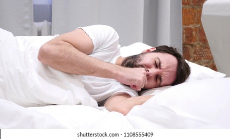 Coughing Sick Man in Bed at Night, Throat Infection, Lying on Side