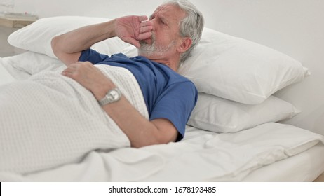 Coughing Sick Senior Old Man Lying in Bed