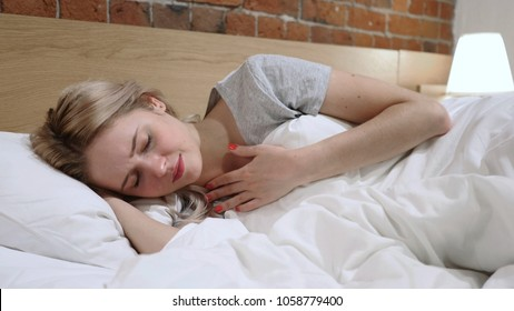 Coughing Sick Woman Lying in Bed On Side, Cough