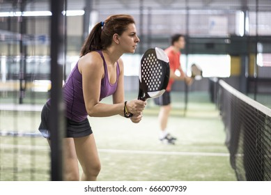 Couiple go to net to attck action in paddle tennis match