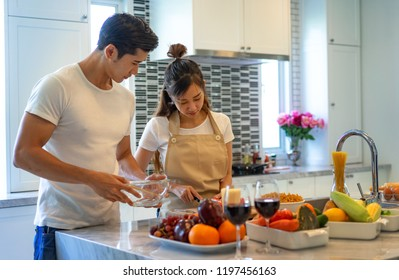 coulpe lover help on each other cooking at home in holidays