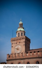Council building tower and clock in Bologna, Italy.