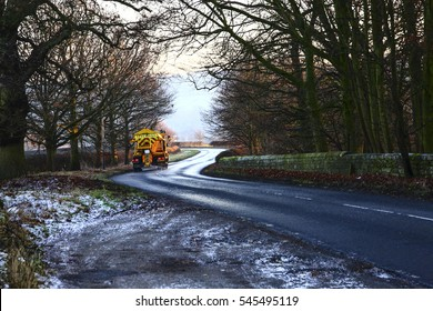 Council gritter spreading salt on a rural road in Wharfedale Yorkshire England UK