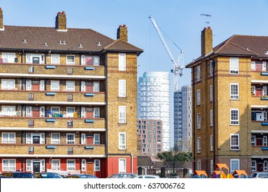 Council housing blocks contrasted with modern high-rise flats in the background