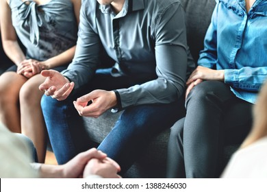 Counseling and conversation in group therapy or meeting. Man sharing story to community. Casual business people in discussion. Peer support, trust and empathy. Treatment together in help center.