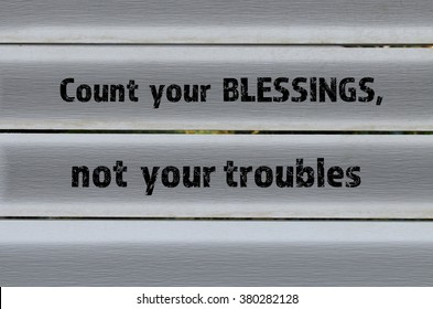 Count your blessings positive message on grey wooden background