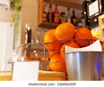 Counter bar with oranges fruits and baskets