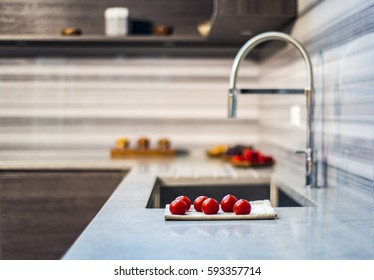 counter with fresh tomatoes and blurry kitchen background