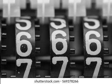 Counter numbers closeup, religious symbol.