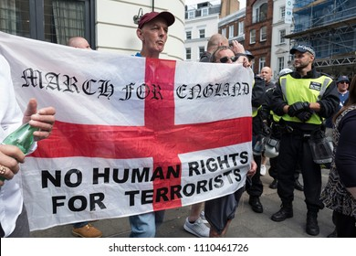 A counter protester holds an English flag in opposition to the Al Quds Day rally, London, 10/06/18.