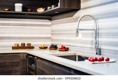 counter top, kitchen brown cabinets, fruits