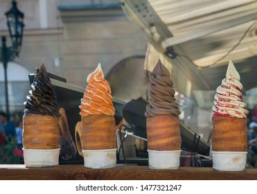 Counter with trdelnik (traditional czech sweet treat) on a street market. Horizontal view, outdoor.