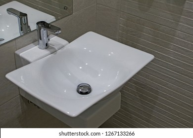 Countertop washbasin in a modern bathroom. The washbasin of ceramics in the bath room with a tap. Bathroom interior with sink and faucet.