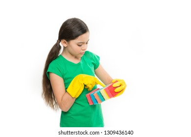 Counting her kitchen sponges. Adorable kitchen maid. Household duties. Small housekeeper holding dish sponges in rubber gloves. Little housemaid ready for household help. Cleaning and washing up.