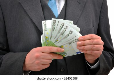 Counting money. Businessman counting euro banknotes.