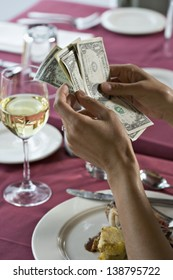 Counting money in restaurant