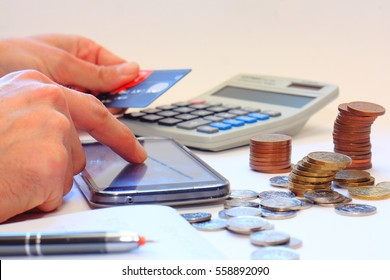 Counting money using calculator and Internet banking on a mobile phone