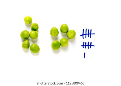 counting peas on white background