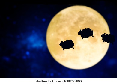 Counting sheep silhouette over a full moon