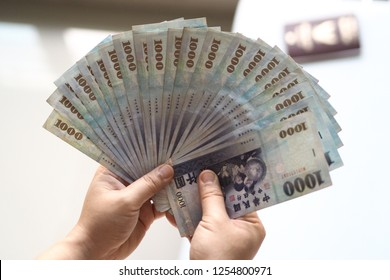Counting Taiwan Dollars currency preparing go on aboard in holiday of Salaryman / foreigner Labour who work onboard