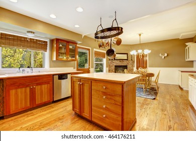 Country American farm house kitchen interior. Large room with hardwood floor, kitchen island and breakfast area. Northwest, USA