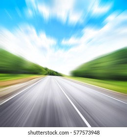 Country asphalt road in motion blur.