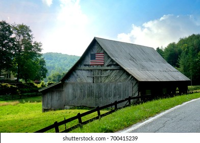 Country Barn with an American Flag