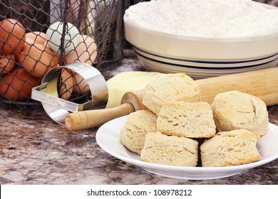 Country biscuits with fresh butter, eggs and flour. Shallow depth of field.