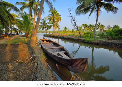 A country boat kept in a narrow canal which forms part of the Kochi backwaters.