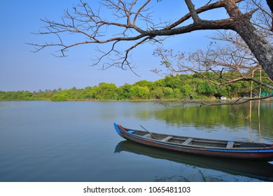 A country boat parked on the banks of Vembanad lake in Cochin.