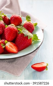 Country fresh strawberries right from the garden on a blue table