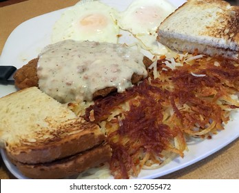 Country Fried Steak and Egg Breakfast with Toast and Hash Browns