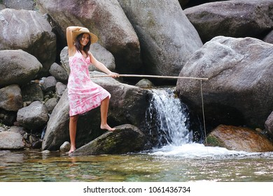 Country girl fishing in a mountain river. Fun and relax