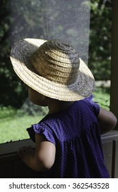 Country girl looking out of screened porch