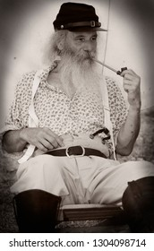 Country Heritage Park, Milton, Ontario, Canada - August 20, 2011: Snake oil salesman or grifter smoking a pipe during a civil war re-enactment