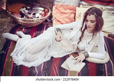 Country hippie girl reading a book