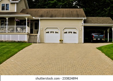 Country home with a double garage and a truck under carport