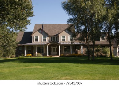 Country Home with a green lawn in the Summer time