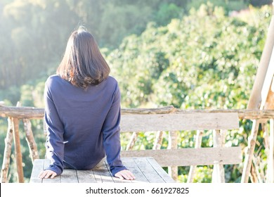 Country home with happy healthy nice hair woman feeling good during vacation in natural resort interior. Simple lifestyle people in fresh cozy outdoor park comfortable relaxing morning