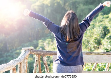 Country home with wellbeing relaxed nice hair woman feeling good during vacation in natural resort interior. Happiness Happens Day