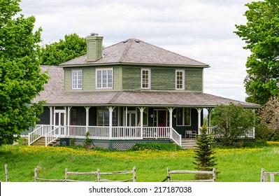 Country home with a wrap-around veranda