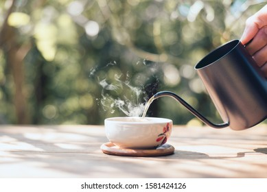 Country hot tea, Pouring tea onto the teacup, Close-up