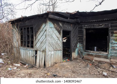 Country house after the fire. The skeleton of a burnt wooden house. Broken charred dwelling. Broken door windows, black walls, fire misfortune