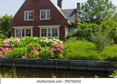 Country house with flowers garden on the front yard