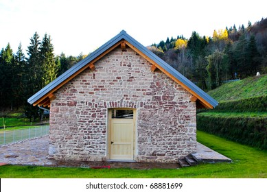 country house in the meadow with the wood background